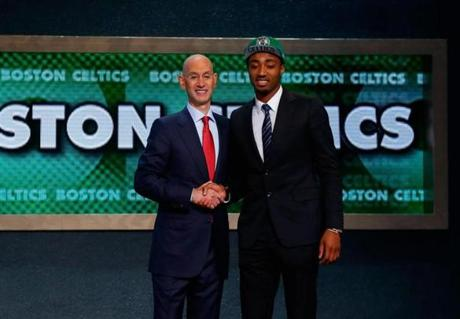 James Young (right) shook hands with NBA Commissioner Adam Silver.